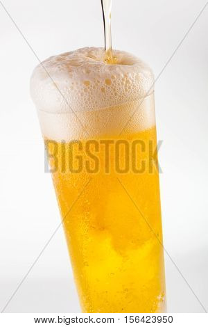 Serving a refreshing ice cold Pilsner beer