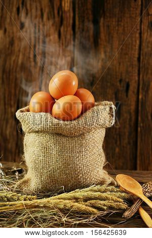 Fresh eggs on wooden background from farm and prepare for cook in kitchen room, Organic food and clean food for healthy, Eggs from farm to the market for raw material to cooking by chef in restaurant.