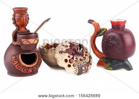 Armenian ancient doll souvenir for salt and pepper pomegranate cup isolated on white background.