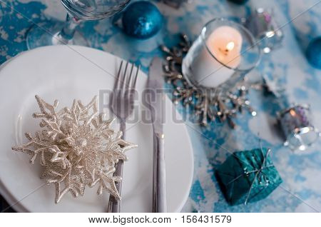 Silver And Cream Christmas Table Setting With Decorations