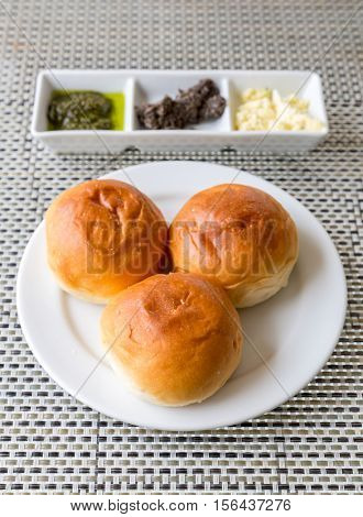 Dinner roll bread Fresh baked with assorted butter in white plate for dinner course