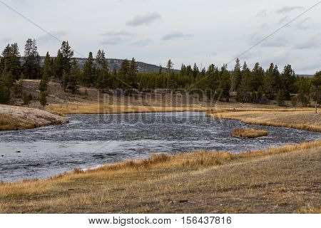 Fishermen fly fishing on Firehole River in Yellowstone National Park.