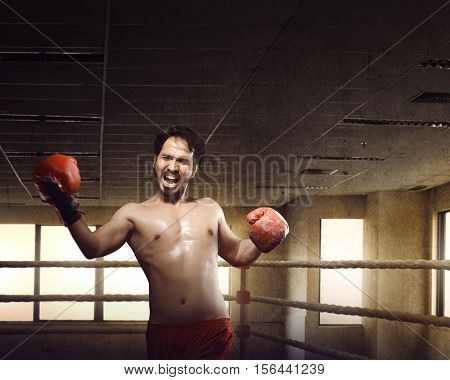 Athlete Male Asian Boxer Doing Uppercuts On Training