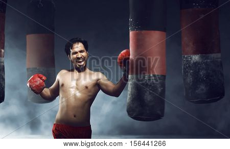 Powerful Asian Male Boxer Doing Exercise