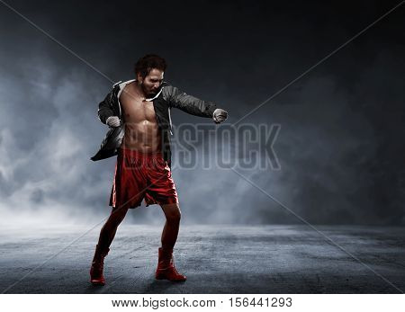 Action Asian Man In Sportswear Using Strap In Wrist Making Punch