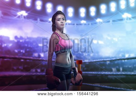 Pretty Asian Girl In Red Boxing Gloves Posing In The Boxing Ring