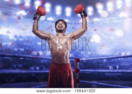 Strong Asian Man Boxer In Boxing Gloves Celebrate His Winning