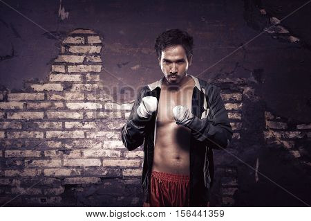 Strong Asian Boxer With Strap In His Hand Waiting For Fight