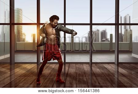 Portrait Of Asian Man Practicing Boxing