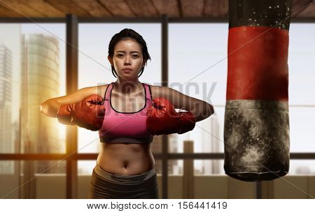 Pretty Asian Girl Boxer Doing Exercise With Punching Bag