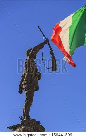 War Memorial Cisternino: soldier with Italian flag.Italy,Apulia. War hero.