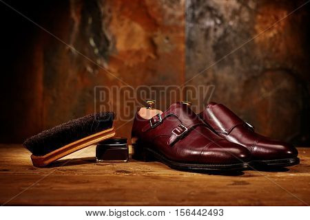 Still life with men's leather shoes and accessories for shoes care