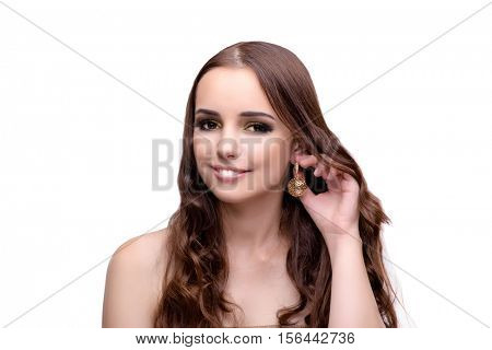 Beautiful woman showing off her jewellery in fashion concept iso