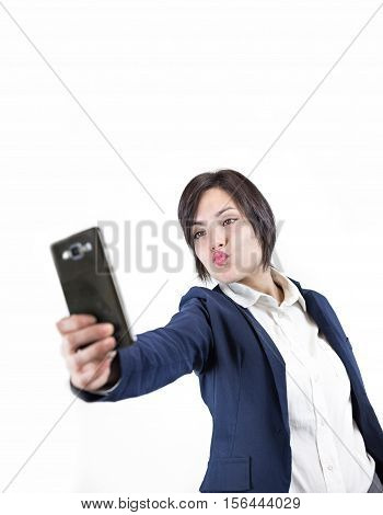 young attractive woman making selfie photo on smartphone isolated on a white background