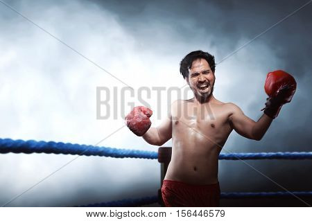 Athlete Male Asian Boxer Performing Uppercut