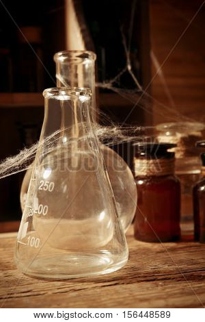 Vintage glass flask with spiderweb, closeup