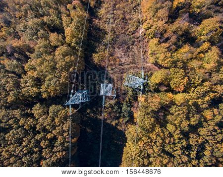 Aerial view. High voltage metal post. High-voltage tower. Top view.