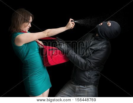 Self Defense Concept. Young Couple Is Defending With Pepper Spra