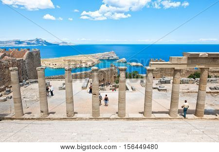 Rhodes Greece - May 19 2010: Tourists in the Acropoli of the Lindos village