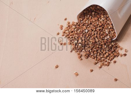 Buckwheat Is Scattered From The White Container,