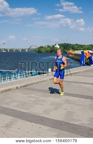 DNEPROPETROVSK - JULY 06, 2013: Egor Martynenko winner of the triathlon men's race at the city streets during Ukrainian opened triathlon championship in Dnepropetrovsk, Ukraine at July 06, 2013 .