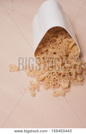 The Pasta Scattered Across The Wooden Surface,