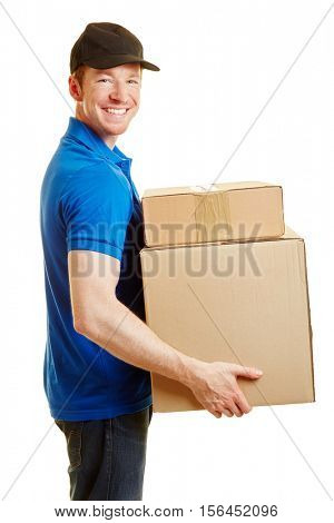 Man as a delivery guy holding packages on his hands and smiling