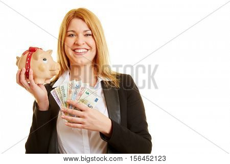 Content woman with money and piggy bank smiling
