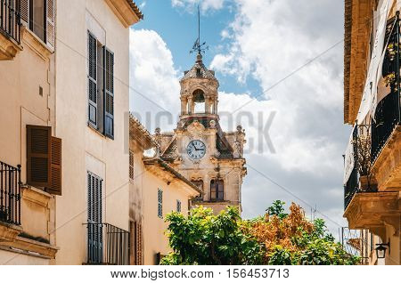 Architecture of Majorca. The tower with big clock of City town hall in Old Town of Alcudia Mallorca Balearic island Spain