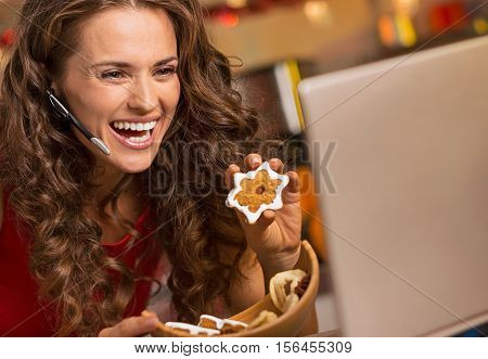 Smiling Young Woman Showing Christmas Cookies While Having Video