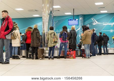 Volgograd, Russia - October 31.2016. Passengers await the luggage around the baggage carousel in C terminalan of Aeroport