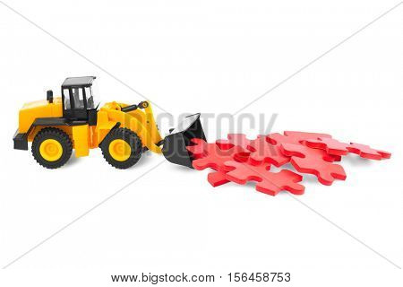 Toy loader with puzzle isolated on white background