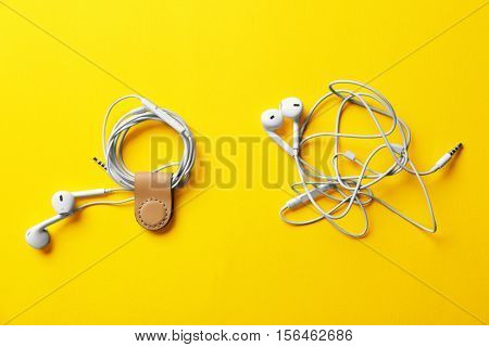 Usage example of multifunctional magnetic clip as earphones cable holder