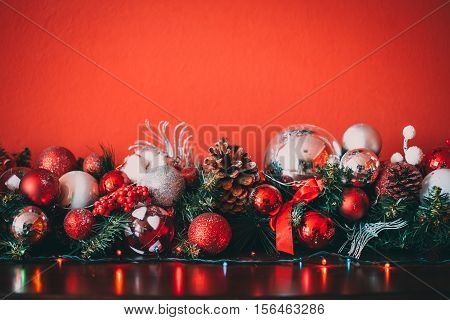 Christmas Decorative Garland With Fir Branches, Red And Silver Baubles, Pine Cones And Other Ornamen