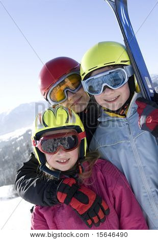 Young smiling girls with ski