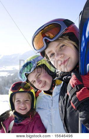 Happy girls with ski