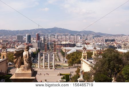 BARCELONA, SPAIN - SEP 13, 2016: Statues on the steps to the National Museum look down toward the Placa d'Espanya and Montjuic on the horizon.