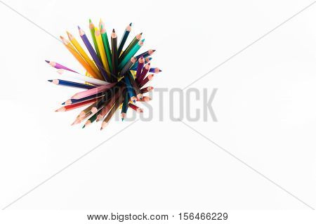 Mockup for artwork with colorful crayons and pastels. Top view. Artistic work tools on white wooden table