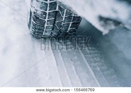 All-season tyre track on snow winter tire concept
