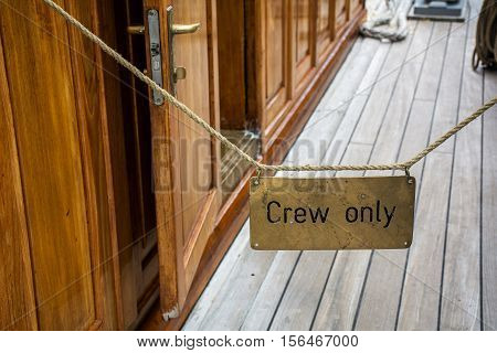 Deck on the ship with inscription For crew only