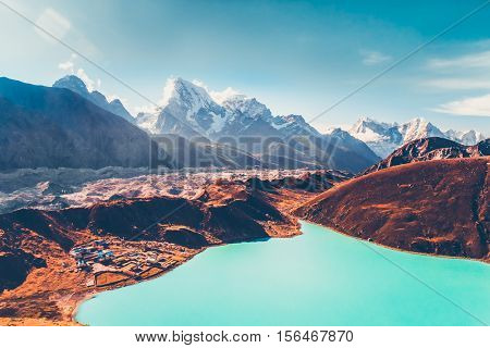 Himalayas. View from Gokyo Ri, 5360 meters up in the Himalaya Mountains of Nepal, snow covered high peaks and lake not far from Everest.