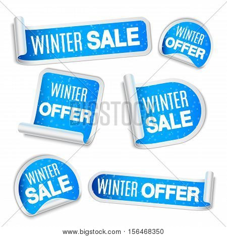 Collection of winter sale and winter offer blue labels, stickers or tags