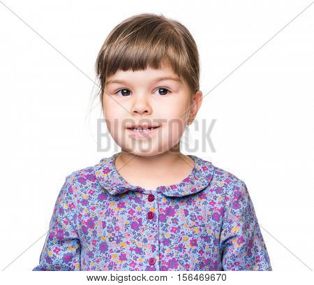 Emotional portrait of a 3 years old girl, smiling. Cute caucasian baby isolated on white background. Beautiful preschool child posing in studio. Healthy carefree kid playing indoors.