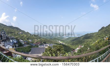 Mountain landscape at Jiufen Taipei city Taiwan under blue sky with fish eye len