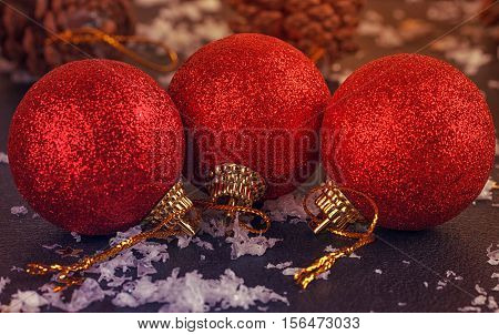 red satin Christmas balls on black background