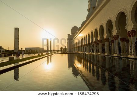ABU DHABI UAE - NOVEMBER 5 2016 : Amazing Mosque. Sheikh Zayed Grand Mosque at sunset time (Abu-Dhabi UAE). Sheikh Zayed. Abu Dhabi