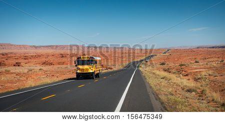 School bus on highway 89 Gray Mountain Arizona USA