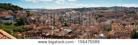 Wide panoramic view over Baixa and Castelo de Sao Jorge from Alfama Lisbon Portugal