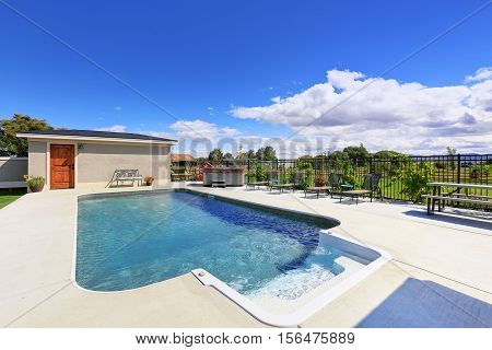 Swimming Pool At The Back Yard Of Luxury House