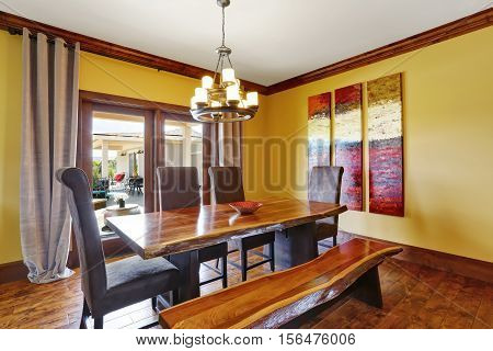 Dining Room Interior. Rustic Wooden Table, Bench And High-back Chairs.